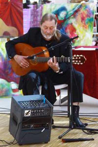 Flamencoguitarist i Flamenco de Colores