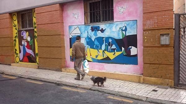 Picasso-maleri på en mur i Malaga