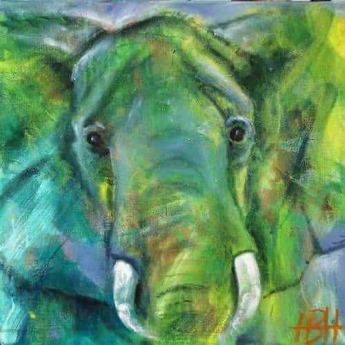 maleri af elefant i grønne og blå farver. Det er kun hovedet, der ses