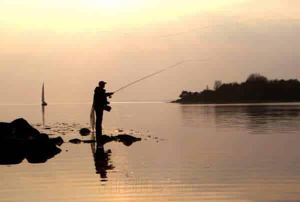 Foto på lærred af fisker ved Vellerup Vig